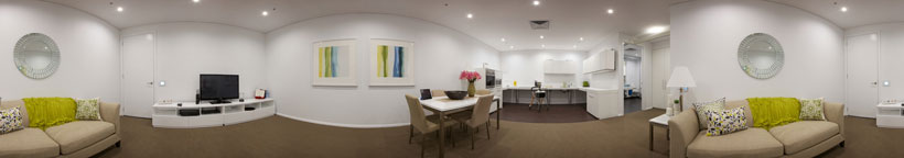 panoramic photograph of the smart apartment showing the lounge room, dining room and kitchen