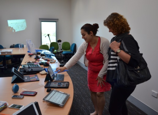 Trainer Rebecca Chedid showing Assistive Technology devices