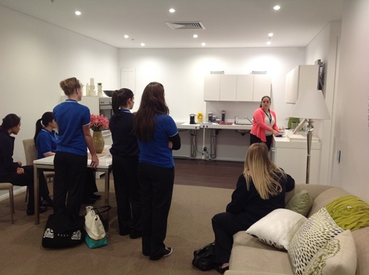 instructor with students at Assistive Technology Australia Display